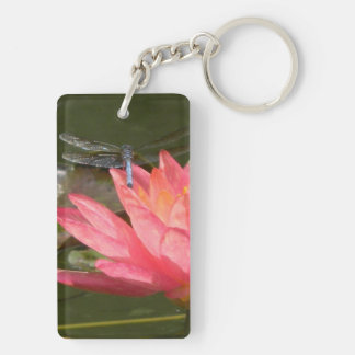 Key fob with flowers and a resting Blue Dragonfly