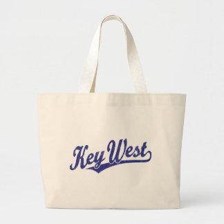 Key West script logo in blue distressed Tote Bags