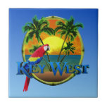 """Key West Sunset Ceramic Tile<br><div class=""""desc"""">Key West beach sunset painting with palm trees,  round bamboo frame,  and a colorful parrot.</div>"""