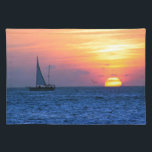 """Key West Sunset Placemat<br><div class=""""desc"""">This beautiful photographs features a loan sailboat creeping by as the late evening sun melts into the Gulf of Mexico off the coast of Key West,  Florida illuminating the evening sky with brilliant colors of golden yellow,  orange and red.</div>"""