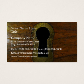 Keyhole in a wooden door business card