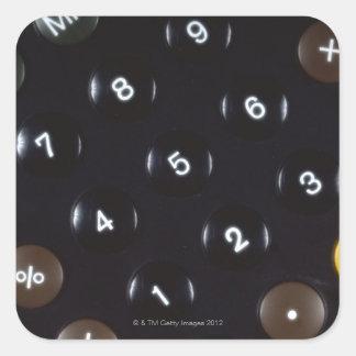 Keys on a calculator square sticker