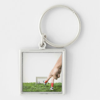 Kicking a soccer ball with finger imitating keychain