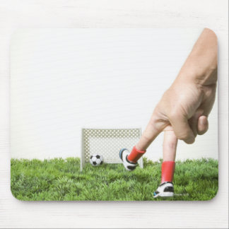 Kicking a soccer ball with finger imitating mouse pad