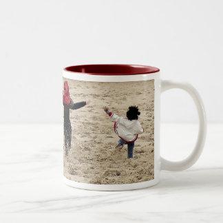 kicking up some sand Two-Tone coffee mug