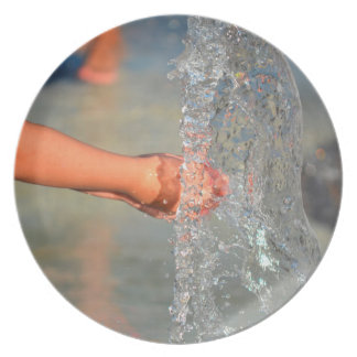 kid hands in water fountain dinner plates