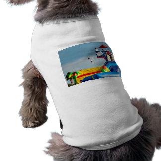 kid jumping off ride at carnival dog clothes