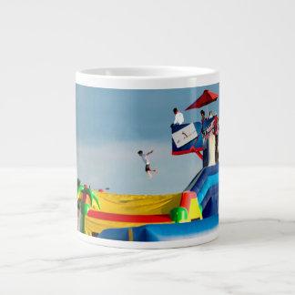 kid jumping off ride at carnival extra large mugs