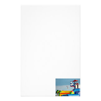 kid jumping off ride at carnival stationery paper
