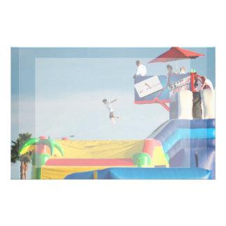 kid jumping off ride at carnival stationery