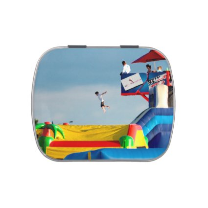 kid jumping off ride colorful painting style candy tin