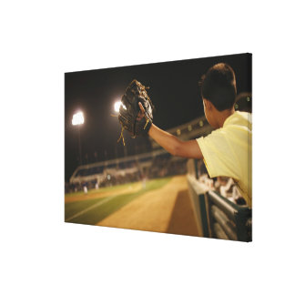 Kid leaning over wall to try and catch 'foul canvas print