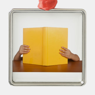 Kid reading a book square metal christmas ornament