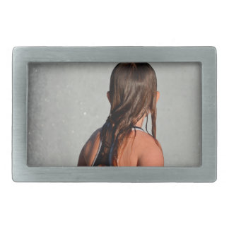 kid with wet hair in fountain belt buckle