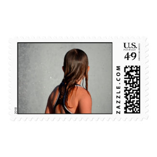 kid with wet hair in fountain postage stamp