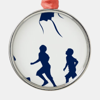 Kids flying a kite. metal ornament