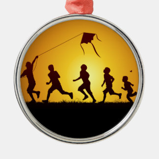 Kids flying a kite metal ornament