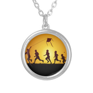 Kids flying a kite silver plated necklace