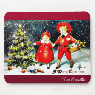 kids going by a cart top covered by santa umbrella mouse pad