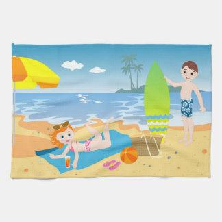 Kids having fun on the beach towels