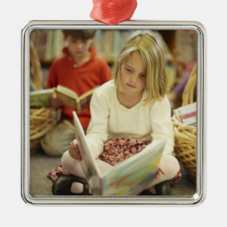 Kids in a library metal ornament
