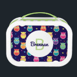 """Kids Monogrammed Midnight Owl Pattern Colorful Lunch Box<br><div class=""""desc"""">Kids Monogrammed Midnight Owl Pattern Colorful Personalized Lunch Box. Beautiful purple, teal, pink, orange, yellow and green cute little owls with brightly colored hearts. Background of both sides of lunch box is dark midnight blue. Front of lunchbox has bright white circle with monogrammed initial in lime green to coordinate with...</div>"""