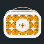 """Kids Personalized Basketball Pattern Sports Cute Lunch Box<br><div class=""""desc"""">Basketball Pattern Sports Personalized Lunch Box. Personalize and monogram this fun sports themed lunch box. White background with a pattern of vintage watercolor style orange basketball pattern. A white circle in the center on both the front and back sides show name in black and initial in orange in an easy...</div>"""