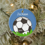 """Kids Personalized Soccer Ball Keepsake Ceramic Ornament<br><div class=""""desc"""">This soccer ball ornament makes a wonderful kids athletic keepsake for Christmas. Easily customize with your information! Click the """"CUSTOMIZE IT"""" button to change the background color,  font style,  color,  size and position. Illustration by www.sanqunettidesign.com</div>"""