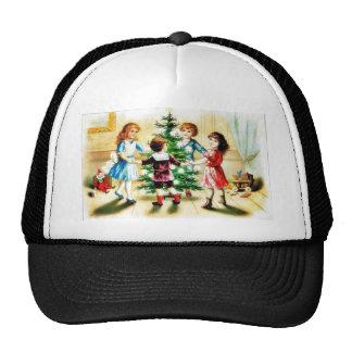 Kids playing around the decorated christmas tree mesh hat