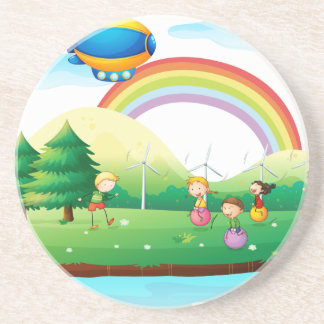 Kids playing in the ground beverage coaster
