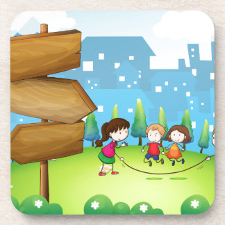 Kids playing in the hills with a wooden signboard beverage coasters