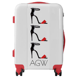 Killer heel shoes on white luggage