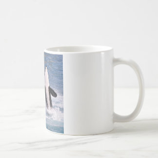Killer whales jumping out of water coffee mug