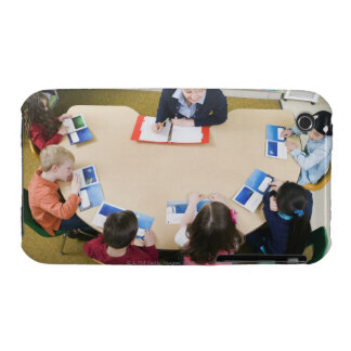 Kindergarten students sitting at table with iPhone 3 Case-Mate cases