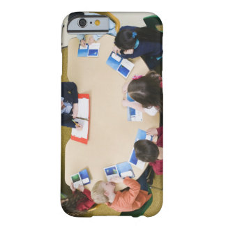 Kindergarten students sitting at table with barely there iPhone 6 case