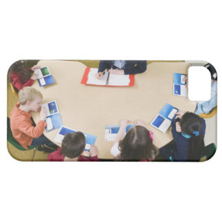 Kindergarten students sitting at table with iPhone 5 case