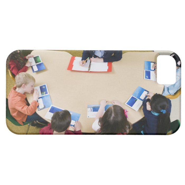 Kindergarten students sitting at table with iPhone SE/5/5s case