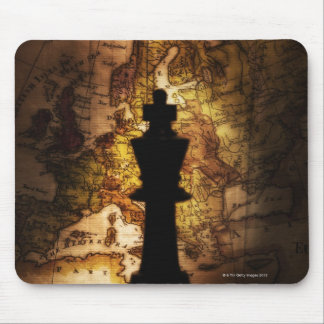 King chess piece on old world map mouse pads