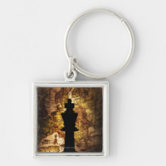 King chess piece on old world map Silver-Colored square keychain
