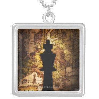 King chess piece on old world map silver plated necklace