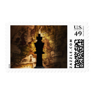 King chess piece on old world map stamp