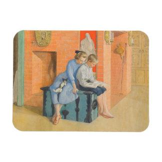 Kirsti y Esbjorn que leen un libro junto Imanes Rectangulares