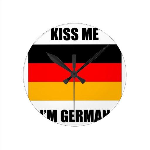 Kiss Me I'm German Round Clocks