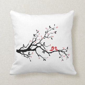 Kissing bird on tree branch with red heart leaves throw pillow