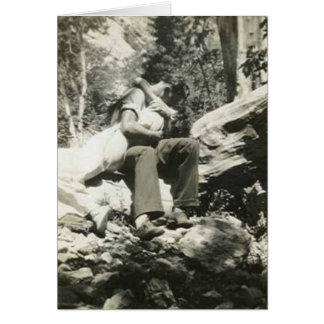 Kissing in the woods greeting card