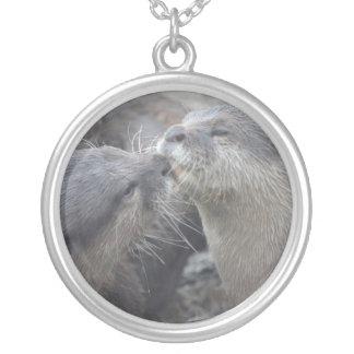 Kissing River Otters Pendants