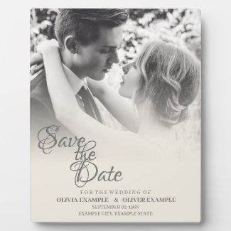 Kissing wedding couple in monochrome plaque