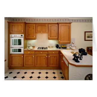 Kitchen interior with breakfast bar and oven card