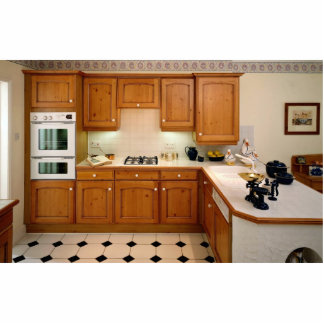 Kitchen interior with breakfast bar and oven statuette