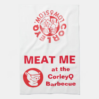 """Kitchen Towel with the """"Meat Me"""" slogan."""